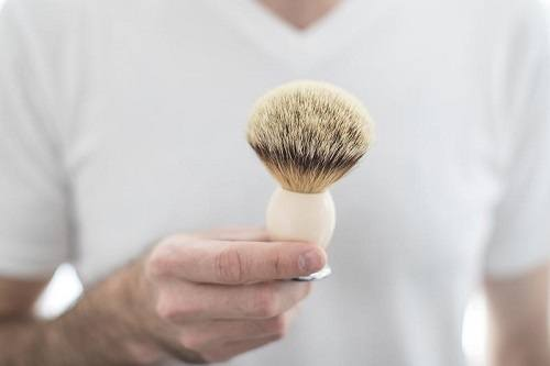 Man Holding Shaving Brush