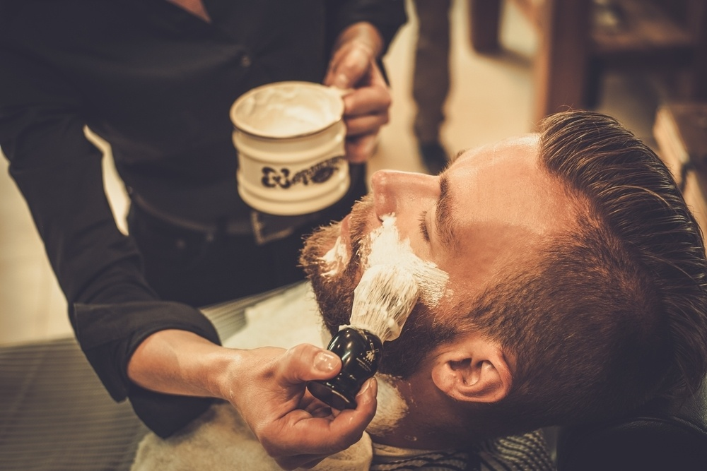 shaving brush being applied by a shaving brush