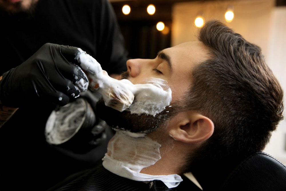 shaving foam being applied on a man