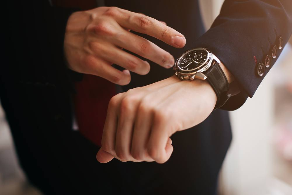 a man with a wrist watch