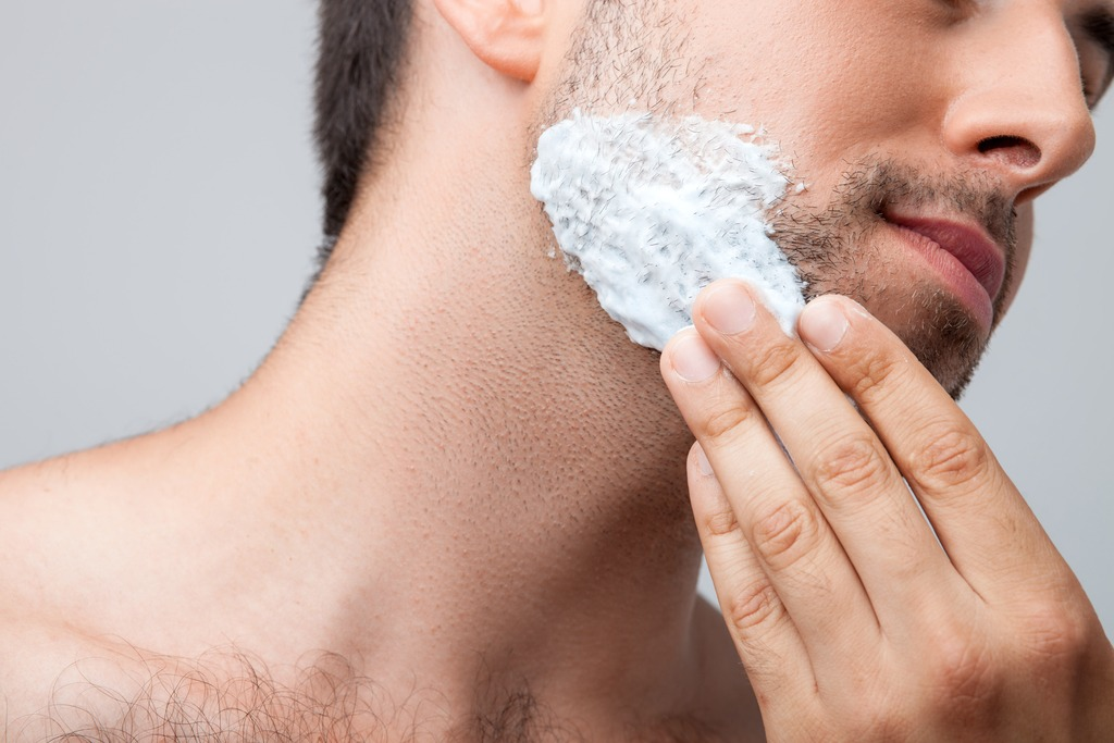Man putting shaving foam on his face