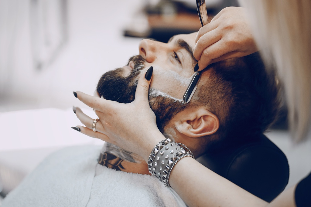 Man midway through a straight shave