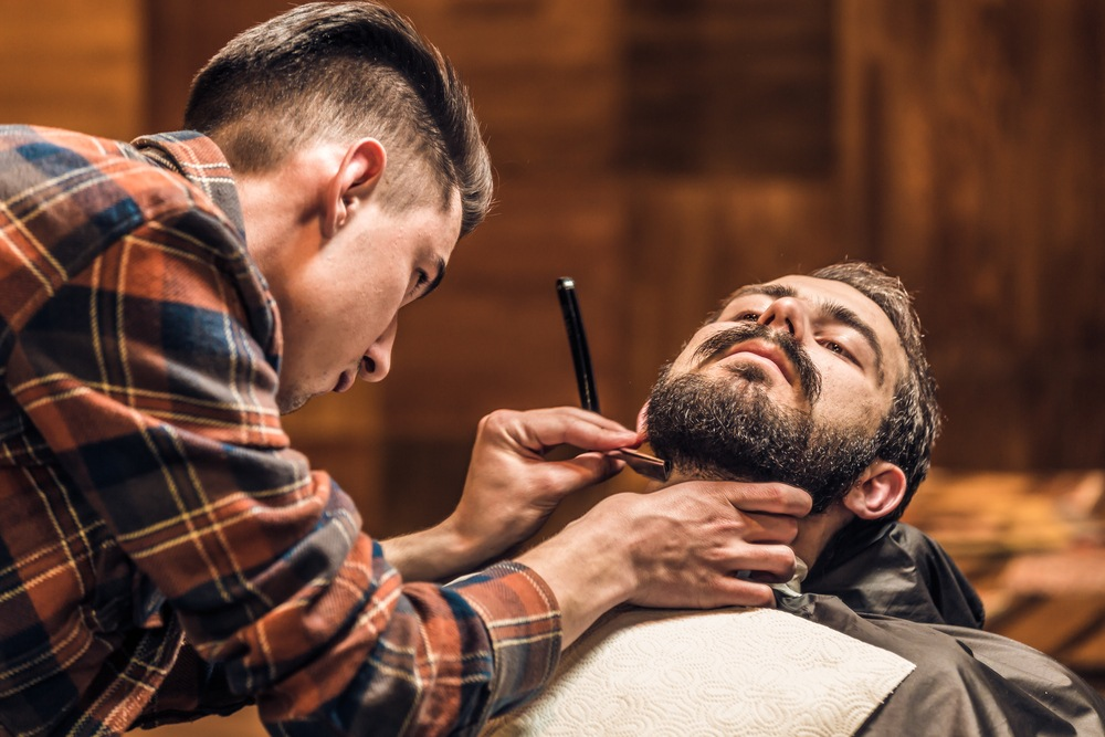 alternative image of a man getting a striaght razor shave