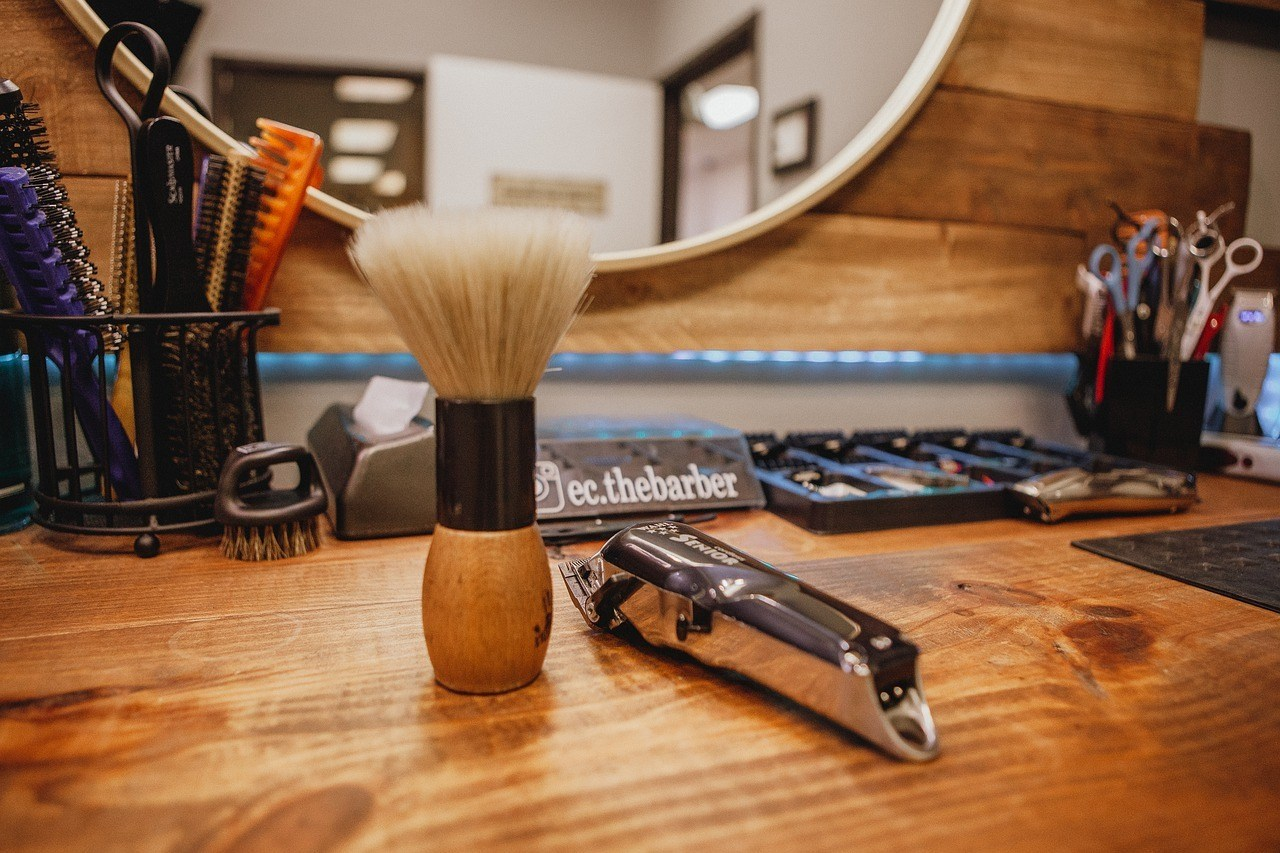 shaving equipment on a table surface/best men's shaving kits