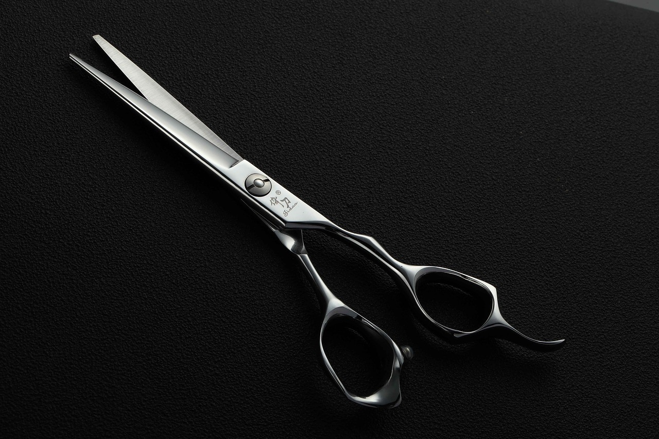 a pair of scissors /trim beard with or against the grain